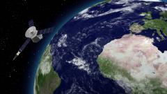 Satellite revolving over earths atmosphere. - stock footage