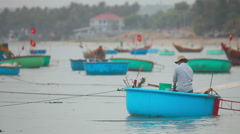 Fishing boats in the bay near the village of Mui Ne Stock Footage