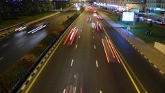 Night street traffic time lapse, car rush away, view from above carriageway - stock footage