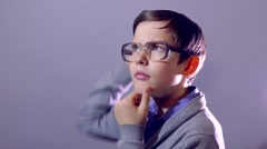 Boy genius thinking with glasses Stock Footage