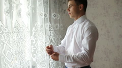 Man buttoning a white shirt Stock Footage