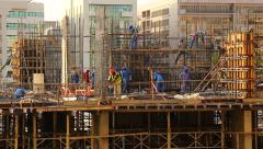 Construction site bustle, workers at rebar frame, long time lapse Stock Footage