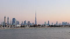 Dusk to darkness time lapse, majestic Dubai skyline from Jumeirah Open Beach Stock Footage