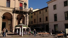 People walk by the Cavour square (Piazza Cavour) in Rimini, Italy. Stock Footage