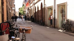 People walk by the street in Rimini, Italy. Stock Footage