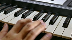 Stock Video Footage of man playing piano synthesizer hand run over the keys
