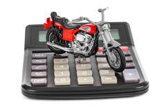 Calculator and toy motorbike - stock photo