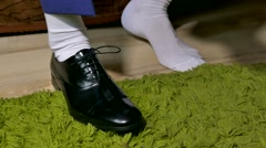 Man in white socks dress  to tie shoelaces shoes Stock Footage