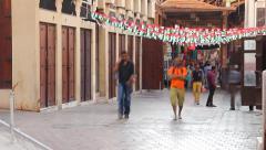 Bur Dubai Old Souk passage, time lapse, people rush through aisle Stock Footage