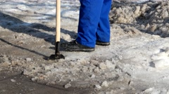 Cleaner Janitor icebreaker breaks the ice and snow in the parking store - stock footage