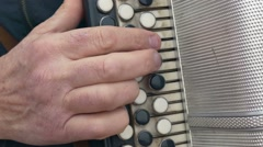Man playing accordion accordion arm Stock Footage
