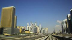 Dubai Marina District from rear cabin of overground metro train, POV time lapse Stock Footage
