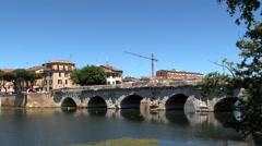 View to the ancient bridge of Tiberius (Ponte di Tiberio) in Rimini, Italy. Stock Footage