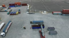 Aerial drone scene while workers are prepairing a shipping, camera moving downwa Stock Footage