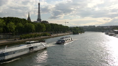 View of sightseeing boats floating on Seine River near Eiffel Tower, Paris Stock Footage