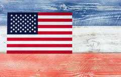 USA flag with national colors painted on fading wooden boards - stock photo