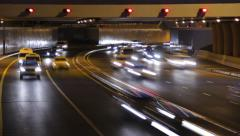 Underpass joint, dark time, vehicles rush towards camera, time lapse. Stock Footage