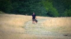 Dog trainer and german shepherd tele Stock Footage
