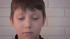 Portrait of little sad desperate kid looking at camera Stock Footage
