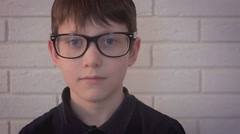 Little  boy nerd wearing glasses portrait looking in the camera Stock Footage