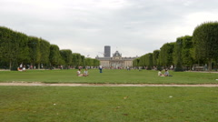 Tourists and locals relaxing in the Champ de Mars, Paris - stock footage