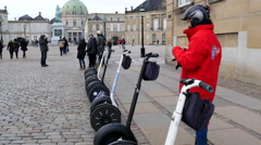Waiting for the Segway riders while they are taking pictures Stock Footage