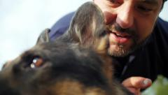 Dog trainer whispering to german shepherd closeup Stock Footage