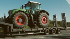 Truck carrying tractor Stock Footage