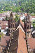 Towers of Freiburg Munster cathedral, Freiburg im Breisgau city, Germany - stock photo