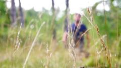 Owner and german shepherd walking in the fields in the background medium shot2 Stock Footage