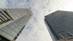 Time Lapse of clouds over glass tower buildings with glass reflection 4k Stock Footage