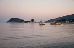 Stock Photo of Cameo Island and Agios Sostis port at dusk