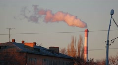 Far Chimney of the Power Plant Smoking at Sunset Stock Footage
