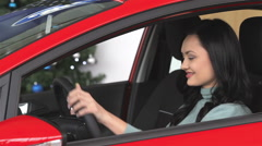 Buyer woman doing thumps-up in car - stock footage