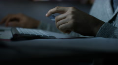 4K Hands of someone inputting credit card details on a computer at night Stock Footage