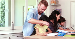 Parents assisting children doing homework Stock Footage