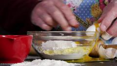 Man tries HAND AT BAKING but FAILs.    Stock Footage