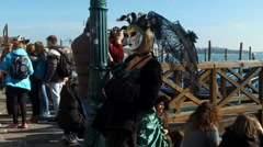 Masked people posing on  St.Marco square in Venice during carnival slow motion 5 Stock Footage