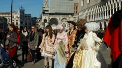 Masked people posing on  St.Marco square in Venice during carnival slow motion 3 Stock Footage