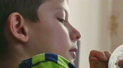 Boy teen eating jelly plastic cup Stock Footage