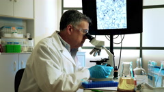 virologist in thought about the cure for zika virus - stock footage