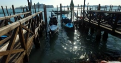 Dock with gondolas and  Square of St.Marco in Venice during carnival steady 4K Stock Footage