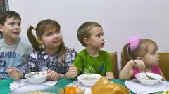 Children eat breakfast  family birthday celebration Christmas Stock Footage