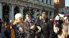 Happy masked people celebrating on  in Venice,Italy slow motion - stock footage