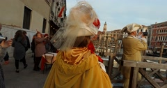 Masked crowd on dock in  Venice during carnival steady shoot 4K Stock Footage