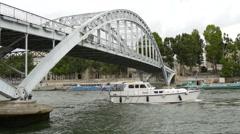 Boats navigating under Passarelle Debilly in Paris Stock Footage