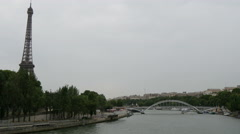 View of Eiffel Tower, Seine River and Passarelle Debilly in Paris Stock Footage