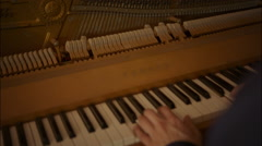 Hands playing classical music at the piano - stock footage