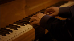 Fingers close up on piano keys - stock footage
