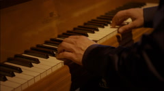 Piano player hands seen from the side - stock footage